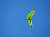 Hang gliding in blue sky