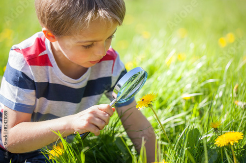 Child exploring nature - 82421089