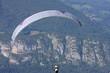 Leinwandbild Motiv paraglider in the Alps