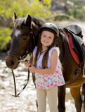 happy child girl with pony horse as young jockey in Summer - 82422664