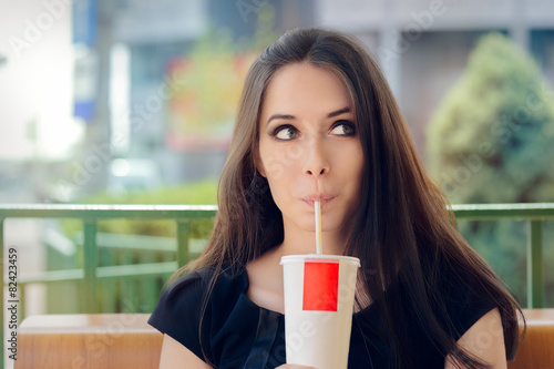 Young Woman Having a Summer Refreshing Drink Outside - 82423459