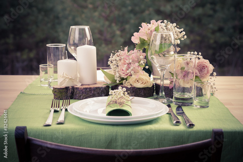 Papiers peints Table preparee Retro stylized photo of wedding table setting in rustic style.