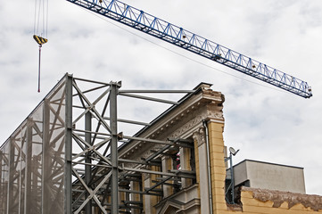 New office building construction with preservation of old facade