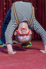 Supple agile little boy doing a back arch