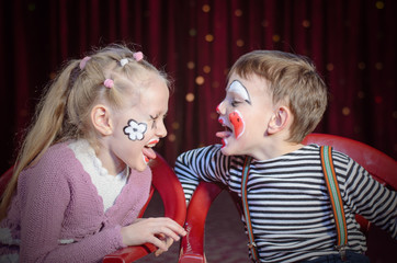 Boy and Girl Clowns Sticking Out Tongues