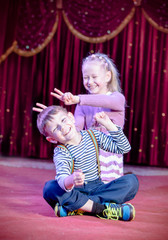 Happy Young Kid Performers at the Stage