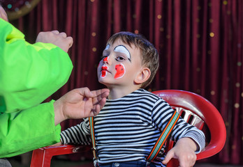 Young Boy Putting Mime Makeup for a Stage Play