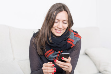 Happy woman texting on cell phone