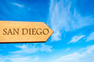 Wooden arrow sign pointing destination SAN DIEGO