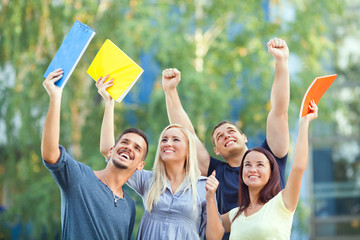 Group of happy students celebrating their succes