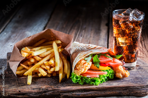 Plexiglas Snack Fresh kebab with fries and cod drink