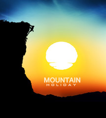 Mountain climb silhouettes with sunset background