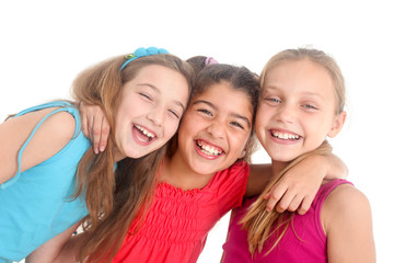 three happy girls on white background