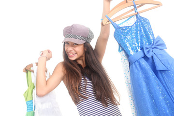 portrait of happy teen girl holding clothes on white background