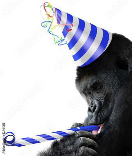 Foto op Canvas Aap Gorilla party animal with a striped birthday hat and noisemaker