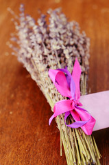 Bunch of dried lavender on brown wooden table