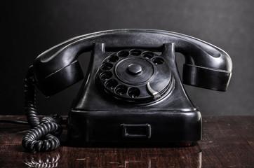 Old black telephone retro style