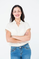 Smiling woman standing arms crossed