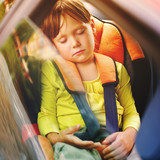 small girl sleeps in car