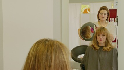 Hairdresser Woman Finishing Hair Cut