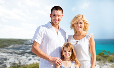 happy family over summer beach background