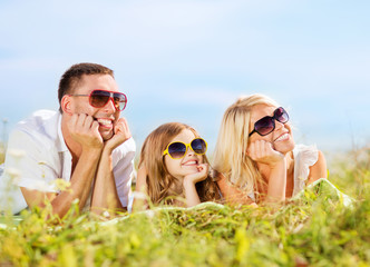 happy family with blue sky and green grass