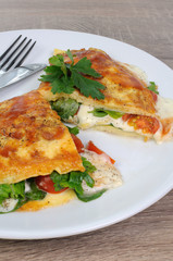Omelet with spinach, tomatoes and mozzarella