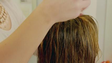 Hairdresser Woman Using Hair Fluid