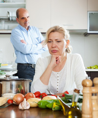 Family conflict in kitchen