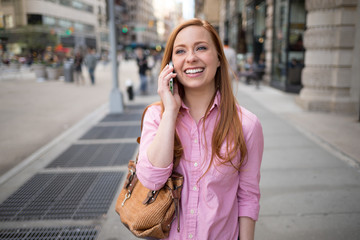 Young caucasian woman in New York City talking on cellphone