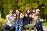 group of students or teenagers showing thumbs up