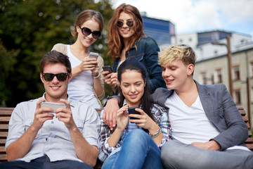 students or teenagers with smartphones at campus