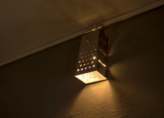beautiful home made diy kitchen grater and lamps on wall