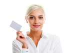 Happy blond woman showing blank credit card
