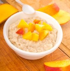 porridge with fresh juicy peach