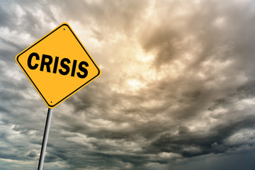 Sign with word 'Crisis' and thunderclouds