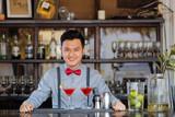 Smiling Asian bartender