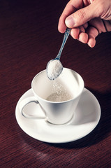 Sifting the blank white sugar cup