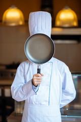 Hiding behind frying pan