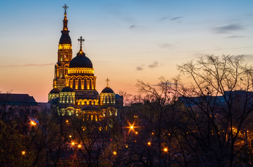 Cathedral church in Kharkiv, Ukraine at sunset with lights