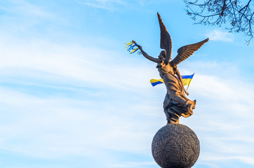Woman monument with Ukraine flag