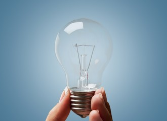 Light Bulb. Hand with lamp and plant