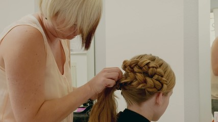 Hairdresser Young Gril Making Cornrows