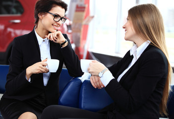 Office workers on coffee break, woman enjoying chatting