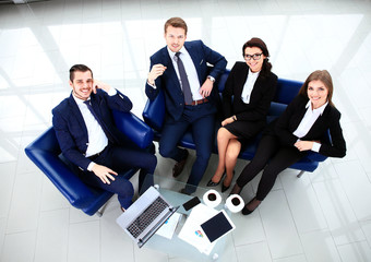 Top view of working business group sitting at table during corpo