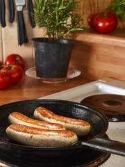 Cooking sausage in a pan