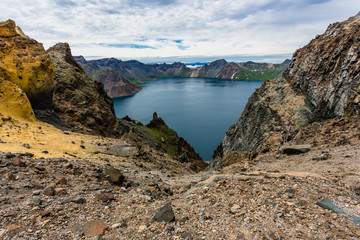Volcanic rocky mountains and lake Tianchi, wild landscape, natio