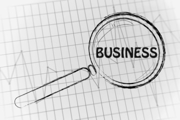 business performance, magnifying glass focusing on business perf