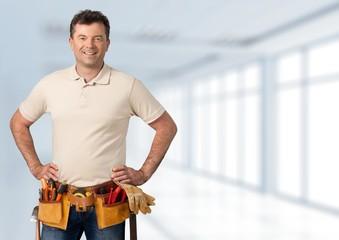 Plumber. Smiling worker on white