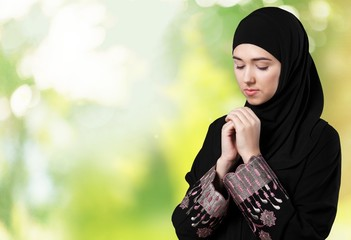 Islam. Muslim young woman wearing hijab on white
